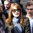 Nicolas Sarkozy et sa femme Carla Bruni sont allés voter aux alentours de 13 heures dans le 16e arrondissement de Paris à l'occasion des élections municipales, le 23 mars 2014.