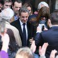 Arrivés à la gare de l'Est d'un train en provenance de Strasbourg, où Carla Bruni se produisait la veille, Nicolas Sarkozy et sa femme se sont rendus directement au bureau de vote du 16e arrondissement à Paris, le 23 mars 2014.