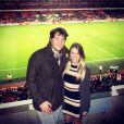 Matthew Stafford, quarterback des Detroit Lions en NFL, et Kelly Hall à l'Emirates Stadium d'Arsenal, à Londres, en février 2014. Le couple s'est fiancé en mars 2014.