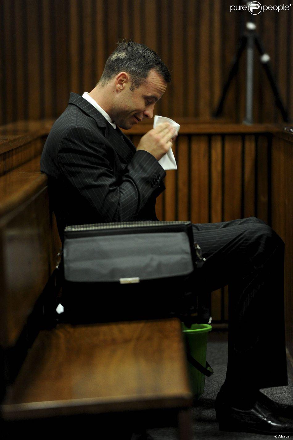 Oscar Pistorius, sur le banc des accusés du tribunal de Pretoria, le 18 mars 2014