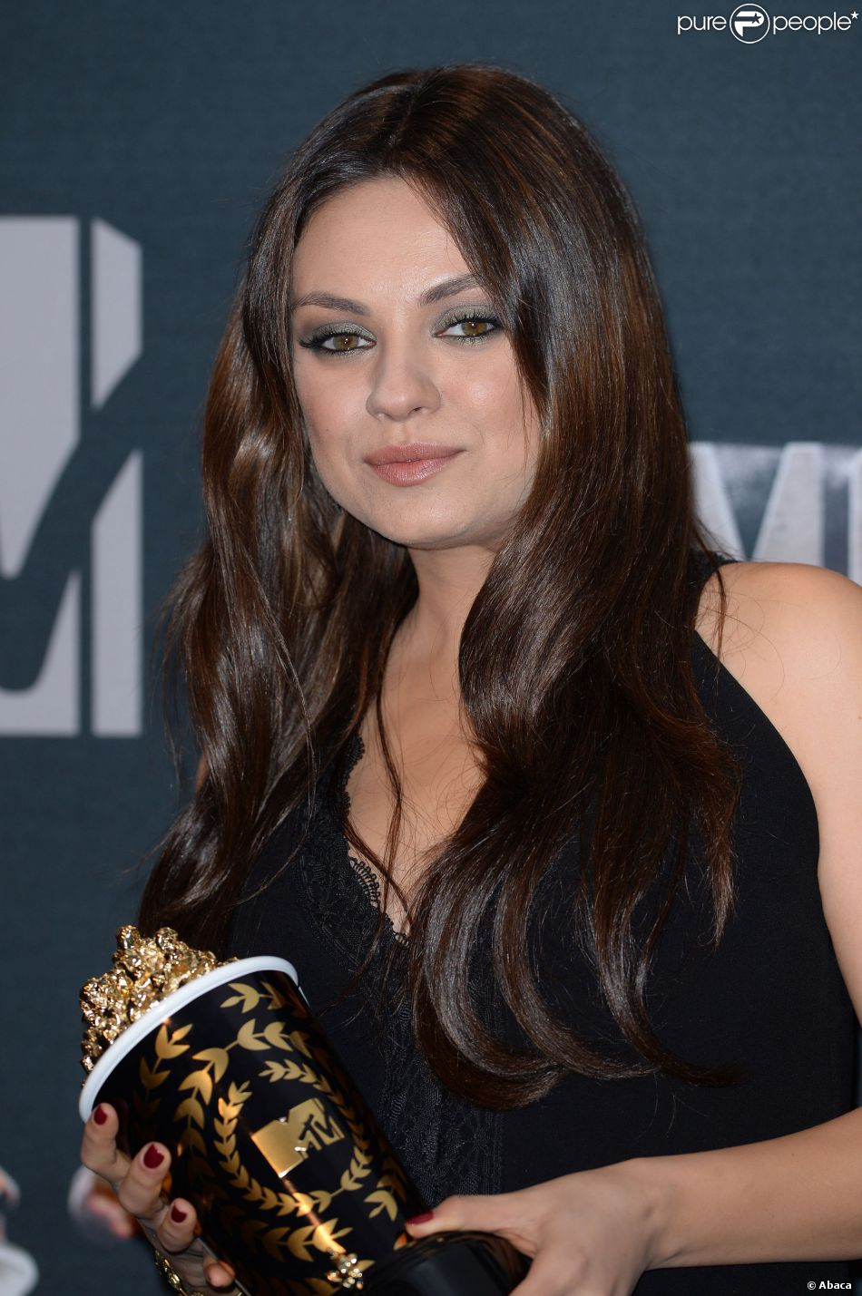 Mila Kunis lors des MTV Movie Award 2014 au Nokia Theatre à Los Angeles, le 13 avril 2014.