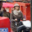 La princesse Madeleine de Suède et son mari Chris O'Neill à New York le 29 mars 2014 lors d'une promenade avec leur fille Leonore.