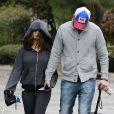 Exclusif - Ashton Kutcher et sa fiancée Mila Kunis promènent leurs chiens à Los Angeles. Le 1er Mars 2014.