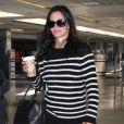 Exclusif - Courteney Cox à l'aéroport de LAX à Los Angeles, le 20 avril 2014.