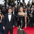 Marine Lorphelin et Bastian Bake, complices, lors de la montée des marches pour le film Grace de Monaco à l'ouverture du 67e Festival de Cannes, sur les marches du Palais des Festivals, de Cannes, le 14 mai 2014