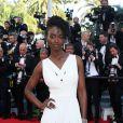 """Aïssa Maïga - Montée des marches du film """"Mr. Turner"""" lors du 67e Festival du film de Cannes le 15 mai 2014"""