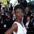 """Aïssa Maiga - Montée des marches du film """"Mr. Turner"""" lors du 67ème Festival du film de Cannes le 15 mai 2014"""
