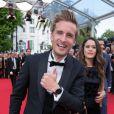 """Philippe Lacheau (portant une montre Montblanc TimeWalker)  et Alice David  - Montée des marches du film """"Dragon 2"""" lors du 67e Festival du film de Cannes le 16 mai 2014"""