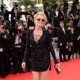 """Sharon Stone (portant une minirobe Emilio Pucci), femme fatale, lors de la montée des marches du film """"The Search"""", au cours du Festival de Cannes le 21 mai 2014"""