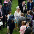 La princesse Beatrice d'York participait avec la reine Elizabeh II et le duc d'Edimbourg, le 21 mai 2014 dans le parc de Buckingham Palace, à la première garden party royale de l'année.