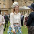 La princesse Beatrice d'York, ravissante dans une jupe Mary Katrantzou etun chemisier Juicy Couture, et coiffée d'un chapeau Robyn Coles, participait avec la reine Elizabeh II et le duc d'Edimbourg, le 21 mai 2014 dans le parc de Buckingham Palace, à la première garden party royale de l'année.