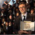 """Nuri Bilge Ceylan, Palme d'Or pour """"Winter Sleep"""" - Photocall de la remise des prix du 67e Festival du film de Cannes le 24 mai 2014."""