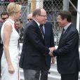 Albert et Charlene de Monaco avec Christian Estrosi le 25 mai 2014 lors du Grand Prix de F1 de Monaco