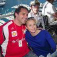 Charlene de Monaco était habillée en bleu lors de sa rencontre avec les membres de l'Association monégasque des Handicapés moteurs le 23 mai 2014 à l'occasion du Grand Prix de F1 de Monaco.