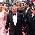 """Isabelle De Araujo (Bijoux APM Monaco), Christian Clavier et Chantal Lauby - Montée des marches du film """"Jimmy's Hall"""" lors du 67e Festival du film de Cannes le 22 mai 2014."""