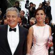 """Christian Clavier et sa compagne Isabelle De Araujo (Bijoux APM Monaco) - Montée des marches du film """"Jimmy's Hall"""" lors du 67e Festival du film de Cannes le 22 mai 2014"""