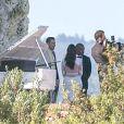 Kim Kardashian et Kanye West pendant leur mariage le samedi 24 mai, au Forte di Belvedere, à Florence. Ils se sont dit OUI devant un mur de fleurs.