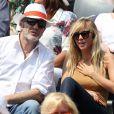 Enora Malagré, accompagnée de William Lowenstein, assiste aux Internationaux de France de tennis de Roland-Garros à Paris, le 31 mai 2014.