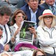 Robert Charlebois et sa femme Laurence, Mireille Darc à Roland-Garros à Paris, le 3 juin 2014.