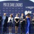 """Eric Woerth (maire de Chantilly), Bertrand Bélinguier, Kate Winslet, Sophie Thalmann lors du 165e """"Prix de Diane Longines"""" à l'hippodrome de Chantilly le 15 juin 2014."""