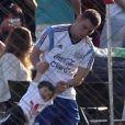 Lionel Messi s'entraîne avec son fils Thiago le 22 juin 2014 à Belo Horizonte pendant la Coupe du monde au Brésil.