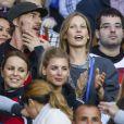 Sylwia, femme de Miroslav Klose, avec Lisa, Sarah Brandner et Lisa-Maria, compagnes respectives de Roman Weidenfeller, Bastian Schweinsteiger et Ron-Robert Zieler, avec le créateur Thomas Hayo lors du match Allemagne-Algérie à Porto Alegre (Brésil) le 30 juin 2014.