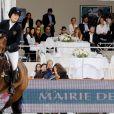 Jessica Springsteen sous les yeux de ses parents Bruce Springsteen et sa femme Patti Scialfa, en compagnie de Elliott Murphy et sa femme - Paris Eiffel Jumping, présenté par Gucci, au Champ de Mars à Paris le 5 juillet 2014.