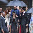 Emma Watson quitte l'hôtel Salomon de Rothschild à l'issue du défilé Valentino haute couture automne-hiver 2014-2015. Paris, le 9 juillet 2014.