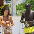 Le footballeur international français, Bacary Sagna, fait du jet-ski avec sa femme Ludivine à Miami, le 19 juillet 2014