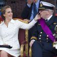 La princesse Claire et le prince Laurent de Belgique lors du défilé militaire de la fête nationale, à Bruxelles, le le 21 juillet 2014.
