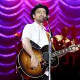 Justin Timberlake souhaite un joyeux anniversaire en chanson à Julian Delan, 8 ans et atteint d'autisme, lors de son concert au SAP Center de San Jose. Le 11 août 2014.
