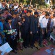 Benedict Barboza, veuf de Jacintha Saldanha, qui s'est suicidée en décembre 2012 après avoir été piégée dans un canular concernant la grossesse de la duchesse de Cambridge, et leurs enfants Lisha et Junal lors des funérailles de l'infirmière le 17 décembre 2012 en Inde