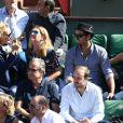 Julie Ferrier, Sofia Essaïdi et son compagnon Adrien Galo dans les tribunes de Roland-Garros lors de la demi-finale de la Coupe Davis le 12 septembre 2014.