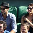 Sofia Essaïdi et son compagnon Adrien Galo dans les tribunes de Roland-Garros lors de la demi-finale de la Coupe Davis le 12 septembre 2014.