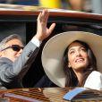 George Clooney et son épouse Amal Alamuddin quittant l'hôtel Cipriani pour se rendre au palais de Ca Farsetti à Venise, le 29 septembre 2014 pour leur mariage civil à la mairie de Venise qui va officialiser la cérémonie de samedi soir.