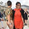 L'Ukrainien Vitalii Sediuk frappe encore en posant au côté de la chanteuse Ciara, à son arrivée à l'Espace Éphémère du jardin des Tuileries, où s'est déroulé le défilé prêt-à-porter Valentino. Paris, le 30 septembre 2014.