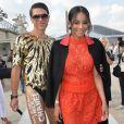 L'Ukrainien Vitalii Sediuk frappe encore en posant au côté de la chanteuse Ciara, à son arrivée à l'Espace Éphémère du jardin des Tuileries, où s'est déroulé le défilé prêt-à-porter Valentino. Paris, le 30 septembre 2014. (crédit AbacaTV)