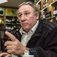 """Gérard Depardieu visite une boutique """"Wine Express"""" qui va commercialiser son vin dans la station de train Kursky à Moscou, le 5 novembre 2013."""