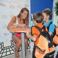 Laure Manaudou présente sa collection de maillots de bain 'Laure Manaudou Design' lors d'un défilé à la piscine de Boulogne-Billancourt le 2 Juillet 2014
