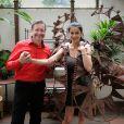 Jovanka Sopalovic et le chocolatier Jean-Claude Jeanson lors de l'essayage de sa robe à l'Hôtel Best Western Premier Trocadéro La Tour le 29 septembre 2014 pour le defilé du 20e Salon du Chocolat, à Paris