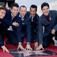Joey McIntyre, Jordan Knight, Donnie Wahlberg, Danny Wood et Jonathan Knight, les membres des New Kids on The Block reçoivent leur étoile sur le Hollywood Walk of Fame à Los Angeles, le 9 octobre 2014.