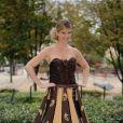 Louise Ekland essaye la tenue qu'elle portera au Salon du Chocolat le 28 octobre 2014.