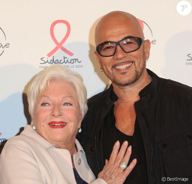 Line Renaud et Pascal Obispo lors du photocall du lancement de l'album des 20 ans de Sidaction à l'Elysée Biarritz, à Paris le 22 octobre 2014.