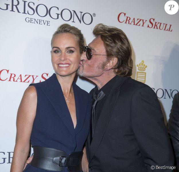 Johnny et Laetitia Hallyday plus in love que jamais lors de la soirée De Grisogono à Paris le 23 octobre 2014.