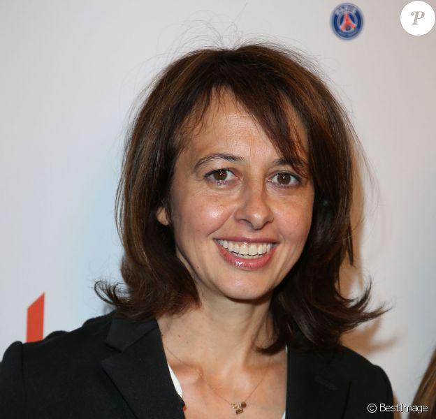 Charity Day BGC 2014 - Valérie Bonneton - Courtier d'un jour pour encourager les clients à passer ce jour là le maximum d'ordres dans la salle des marchés d'Aurel BGC Rue Vivienne à Paris.