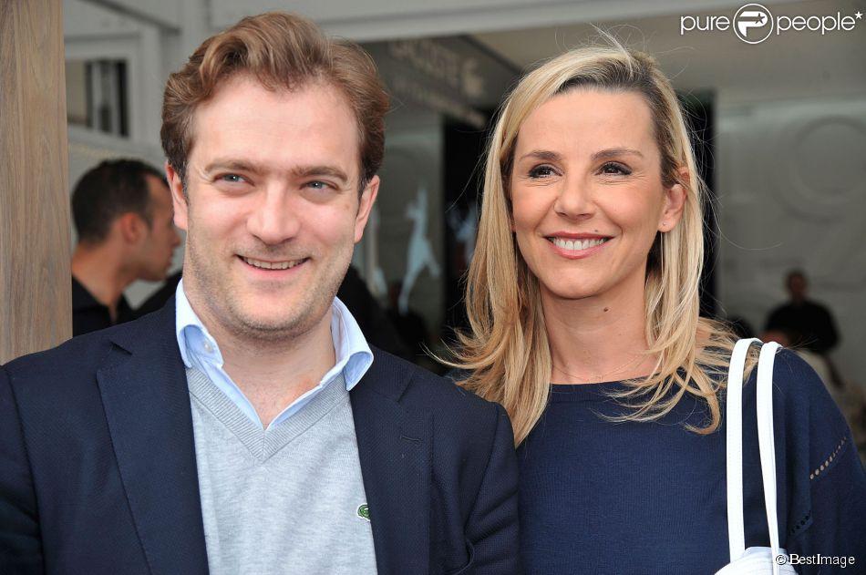 Laurence Ferrari et son mari Renaud Capuçon posant au village des Internationaux de France de tennis de Roland Garros à Paris, le 3 juin 2014.