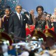 Barack Obama, son épouse Michelle, leurs filles Malia et Sasha au côté de la chanteuse Rita Ora lors de l'enregistrement du concert Christmas in Washington à Washington, le 14 décembre 2014