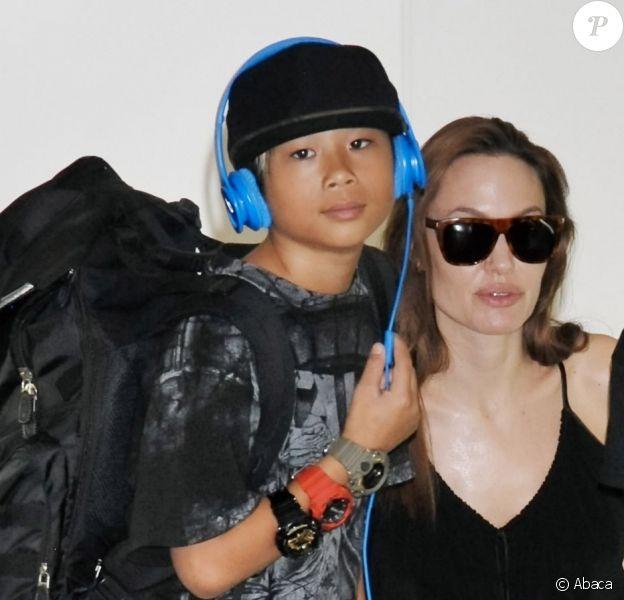 Angelina Jolie et Pax arrive à Tokyo, le 21 juin 2014.