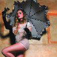 """Clara Morgane prend la pose pour son calendrier """"Show girl"""". Il s'agit ici de la page de la deuxième quizaine du mois de septembre 2015."""