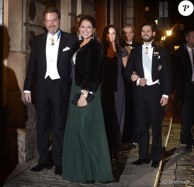 La princesse Madeleine de Suède, enceinte, et son mari Chris O'Neill arrivent à la Bourse de Stockholm pour assister à la soirée de l'Académie de Suède. Le 20 décembre 2014.
